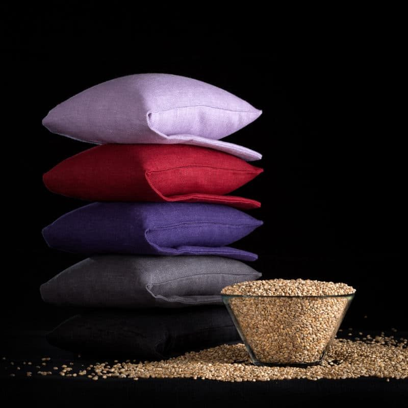 Stack of wheat warmers in lilac, grey and black