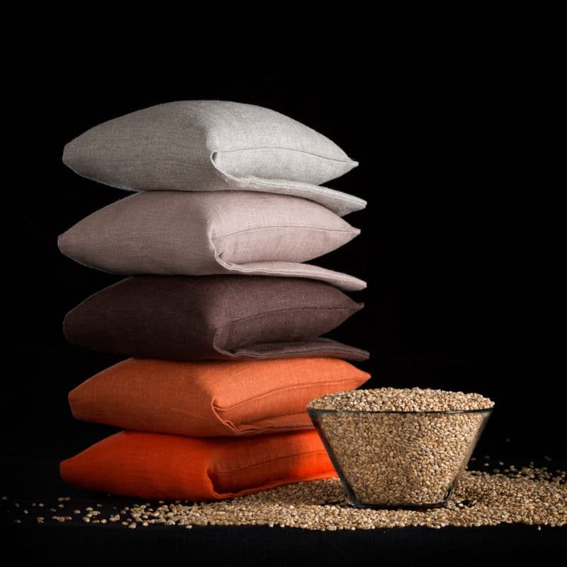 Stack of wheat warmers in nature, nougat, brown and orange
