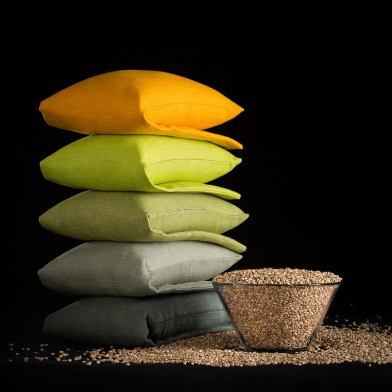 Stack of yellow green olive wheat warmers